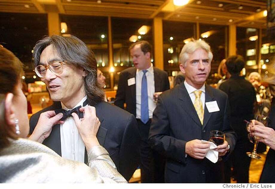 "Linda Kapnick straightened Nagano's tie during the party. ""It was a wife thing, I had to do it,"" she commented. Behind them is David Benoit. Kent Nagano is the conductor of the Berkeley Symphony Orchestra. There's a party at Zellerbach Hall, UC Berkeley campus to celebrate his 25th anniversary of the orchestra. 2/23/04 Berkeley. Eric Luse / The Chronicle Photo: Eric Luse"