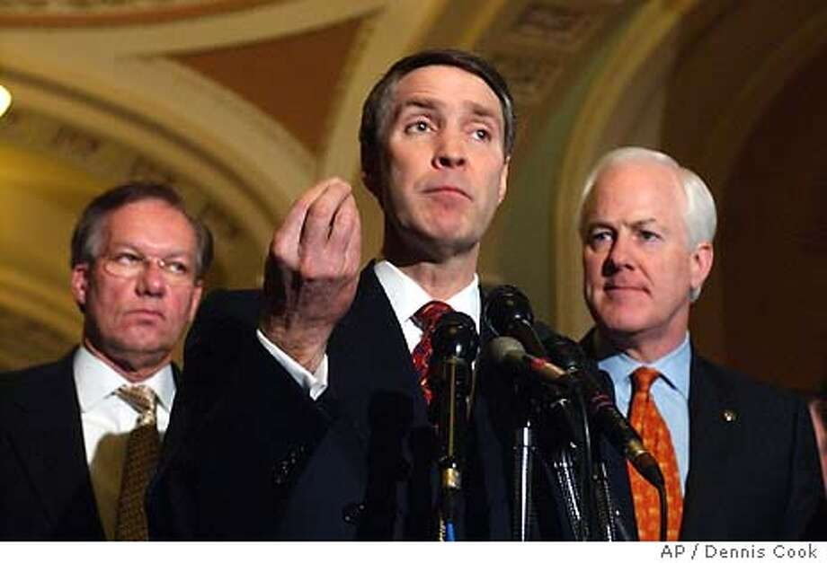 Senate Majority Leader Bill Frist, R-Tenn., joined by Sen. Wayne Allard, R-Colo., left, and Sen. John Cornyn, R-Tex., right, voices support for a constitutional amendment banning gay marriage during a news conference on Capitol Hill, Tuesday, Feb. 24, 2004. (AP Photo/Dennis Cook) Senate Majority Leader Bill Frist R-Tenn., R-Tenn., (center), Sen. Wayne Allard, R-Colo., (left) and Sen. John Cornyn, R-Texas, voice their support for a constitutional amendment banning gay marriage during a news conference on Capitol Hill. Photo: DENNIS COOK