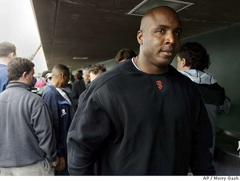 San Francisco Giants Barry Bonds walks away from an press conference in the dugout at Scottsdale Satdium at spring training Monday, Feb. 23, 2004, in Scottsdale, Ariz. (AP Photo/Morry Gash) Photo: MORRY GASH