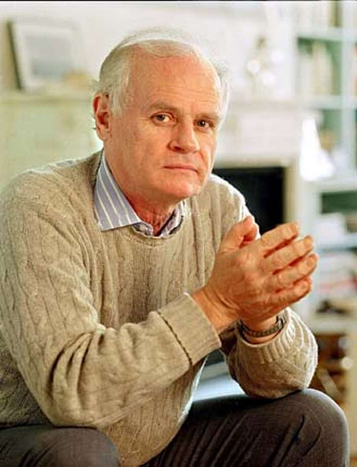 """Author John Gregory Dunne, shown in his New York apartment, incorporates into his writing the three """"P's"""" that once provided escape from the Irish ghetto: politics, priesthood and the police. Reading him is like being approached by a man at a bar who slams his drink on the counetr and tells his life story. Photo: Wyatt Counts"""