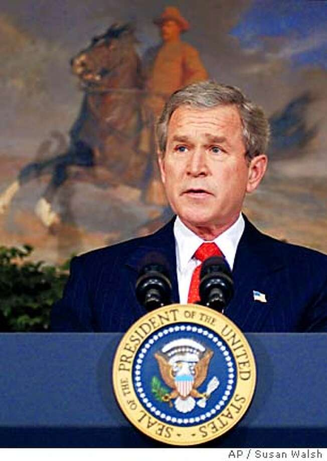 With a portrait of President Theodore Roosevelt behind him, President Bush makes an announcement in the Roosevelt Room of the White House, Tuesday, Feb 24, 2004, that he will back a constitutional amendment banning gay marriage in an attempt to halt same-sex unions like the thousands that have been allowed this month in San Francisco. (AP Photo/Susan Walsh) Photo: SUSAN WALSH