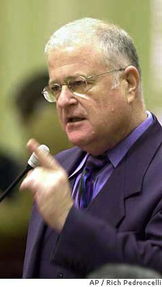 State Sen. Don Perata, D-Oakland, urged passage of a bill to raise vehicle license fees, during the debate over the measure at the Capitol in Sacarmento, Calif., Monday, Feb. 3,2003. The Senate passed the bill 23-16, which is designed, to at least temporarily, to reverse a series of cuts that has reduced the vehicle license fee 67.5 percent since 1998. (AP Photo/Rich Pedroncelli) State Sen. Don Perata Photo: RICH PEDRONCELLI