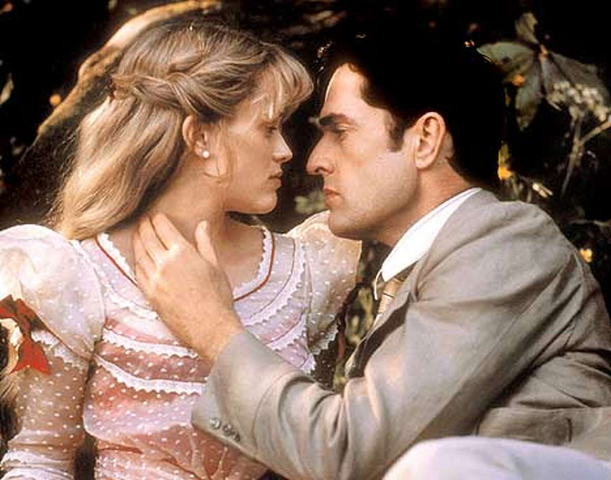 1785RReese Witherspoon and and Rupert Everett in Oliver Parker's THE IMPORTANCE OF BEING EARNEST. Photo Courtesy: Paul Chedlow (HANDOUT PHOTO)