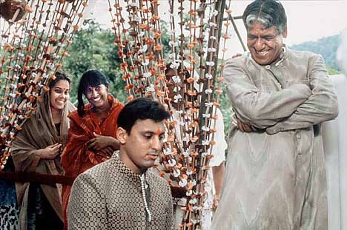 Left to right front: Aasif Mandvi as Ganesh and Om Puri as Ramlogan in,