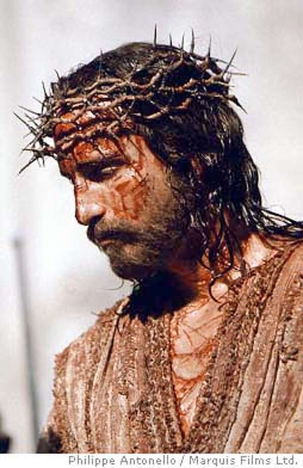 "** ADVANCE FOR WEEKEND, FEB. 19-22 **FILE**Jim Caviezel portrays Jesus Christ on the set of in the controversial new film ""The Passion of the Christ,"" in this Jan. 24, 2003 publicity photo. (AP Photo/Philippe Antonello / Marquis Films Ltd.) Jim Caviezel portrays Jesus Christ in &quo;The Passion of the Christ,&quo; a film notable for extreme violence. Jim Caviezel portrays Jesus Christ in &quo;The Passion of the Christ,&quo; a film notable for extreme violence. Photo: PHILIPPE ANTONELLO"
