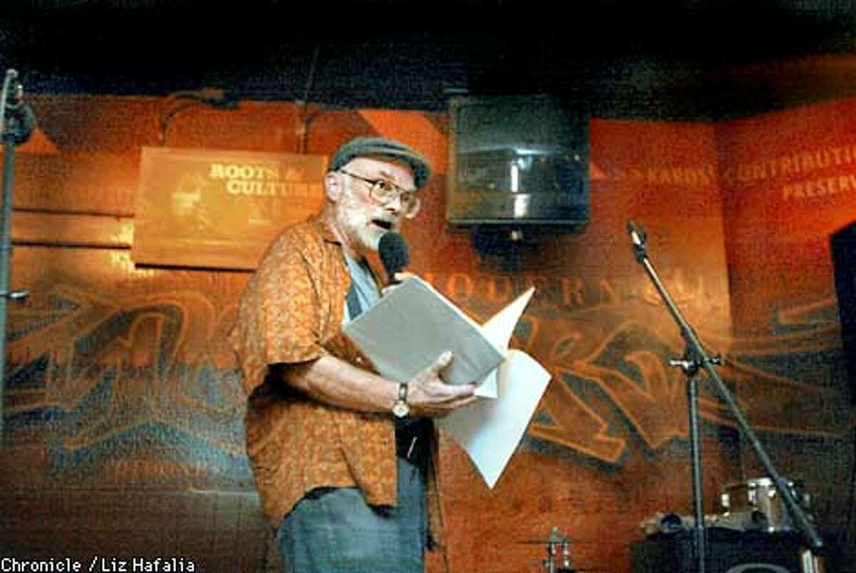 John Pray from Fairfield reading one of his poems at Rapael's Bar and Cafe in Vallejo. He says he frequents poetry readings and mentions this place as his favorite. (PHOTOGRAPHED BY LIZ HAFALIA/THE SAN FRANCISCO CHRONICLE)