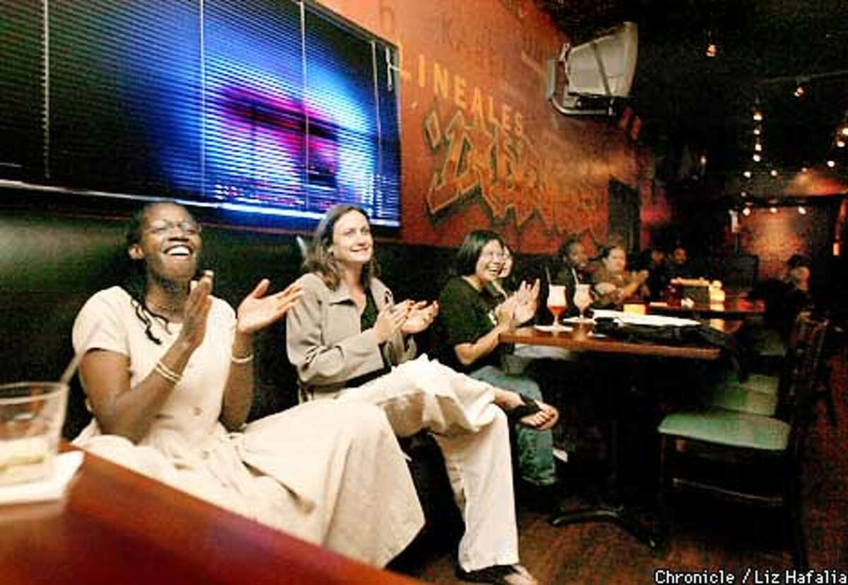 left to right--Felicia Thompson (vocals), Martha Cinader (host), Glynda Velasco (in-house poet), at Rafael's Bar and Cafe in Vallejo listening to featured poet L. Abdul-Kenyatta. (PHOTOGRAPHED BY LIZ HAFALIA/THE SAN FRANCISCO CHRONICLE)