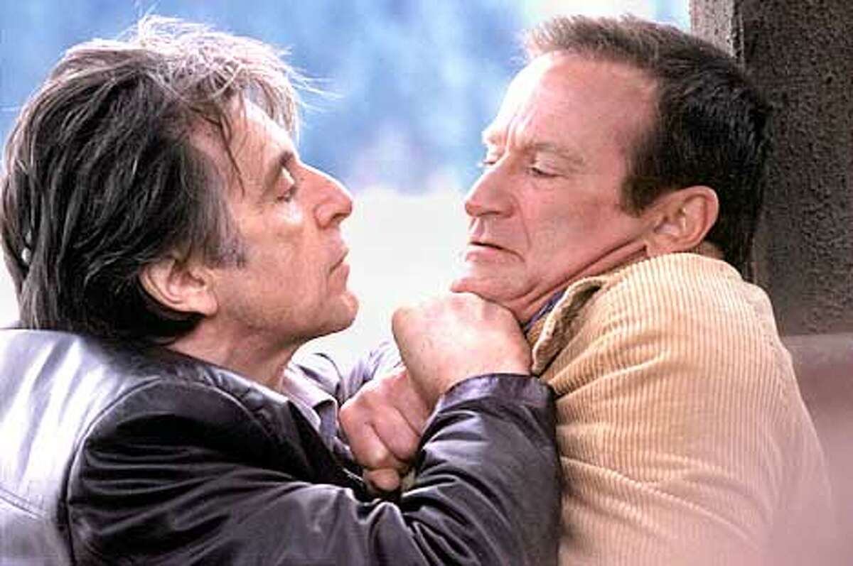 """CT-2786AL PACINO and ROBIN WILLIAMS in Alcon Entertainment's suspense thriller """"Insomnia,"""" also starring Hilary Swank and distributed by Warner Bros. Pictures PHOTOGRAPHS TO BE USED SOLELY FOR ADVERTISING, PROMOTION, PUBLICITY OR REVIEWS OF THIS SPECIFIC MOTION PICTURE AND TO REMAIN THE PROPERTY OF THE STUDIO. NOT FOR SALE OR REDISTRIBUTION (HANDOUT PHOTO)"""