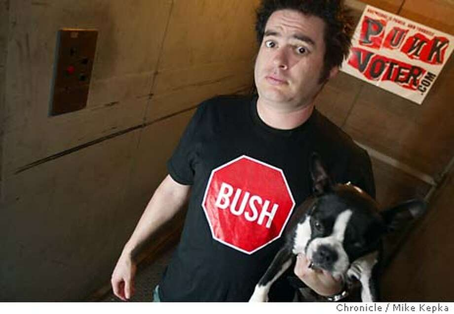 punkxx0011_mk.jpg with his dog Bruiser by his side, Fat Mike, founder of Fat Wreck Chords in San Francisco, is helping to lead a punk movement to get President Bush out of office. He set up a web site called punkvoters.com and his band NOFX is preaching anti Bush learics for all to enjoy. Event on 2/13/04 in El Cerrito. Mike Kepka / The Chronicle Photo: Mike Kepka