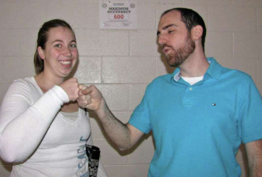 Were you seen on Jan. 29 at the Southern Saratoga YMCA participating in the most simultaneous fist bumps for the Guinness Book of World Records? Photo: Phoebe Sheehan