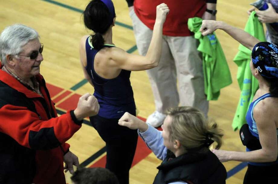 A new world record for fist bumping was achieved Sunday lunchtime Jan. 29, 2012, at the YMCA in Clifton Park N.Y. 428 people were recorded doing simultaneous fist bumps, besting the previous record of 390 set in Australia. (Will Waldron / Times Union) Photo: WW