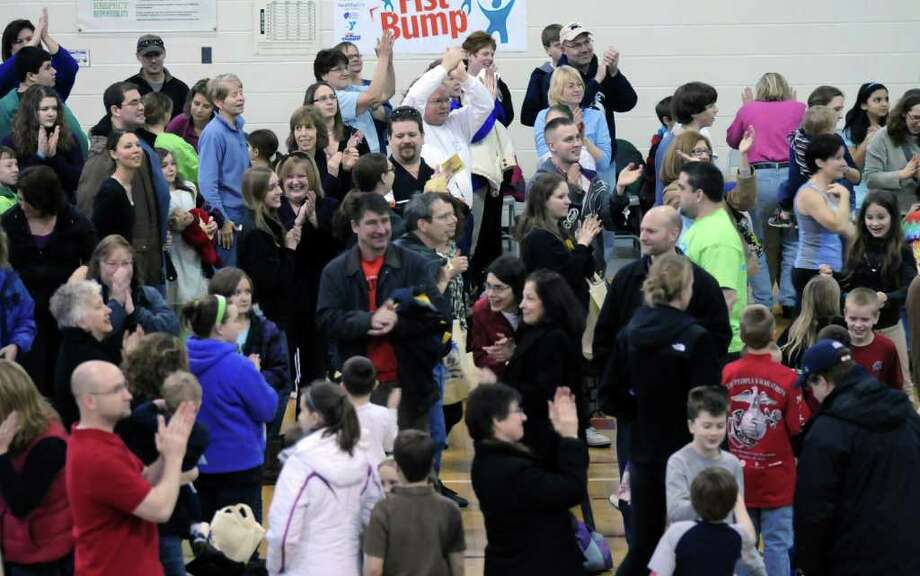 New fist bumping world record holders celebrate their achievement Sunday lunchtime Jan. 29, 2012, at the YMCA in Clifton Park N.Y. 428 people were recorded doing simultaneous fist bumps, besting the previous record of 390 set in Australia. (Will Waldron / Times Union) Photo: WW