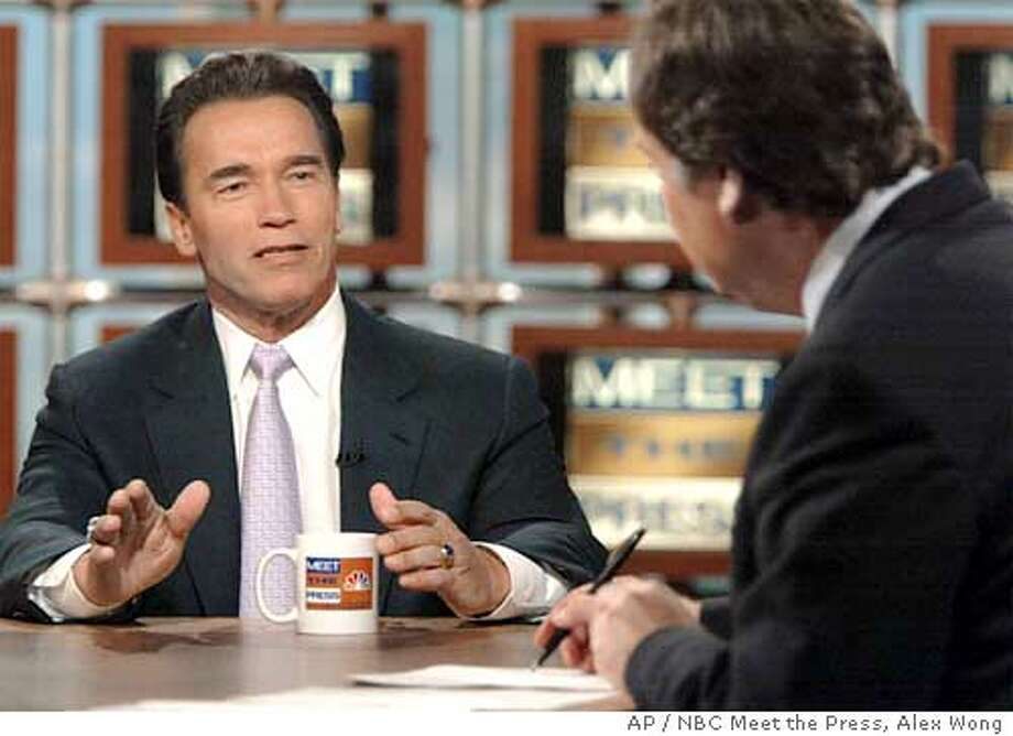 "California Gov. Arnold is interviewed by moderator Tim Russert, right, on NBC's ""Meet the Press"" in Washington, Sunday Feb. 22, 2004. reaffirmed his opposition to the gay marriages that are taking place in San Francisco, and said Mayor Gavin Newsom's refusal to obey the state's law against same-sex marriages could set a bad precedent. (AP Photo/NBC Meet the Press, Alex Wong) ** MANDATORY CREDIT: MEET THE PRESS NO ARCHIVES MUST USE BEFORE 2/29/04 ** Photo: ALEX WONG"