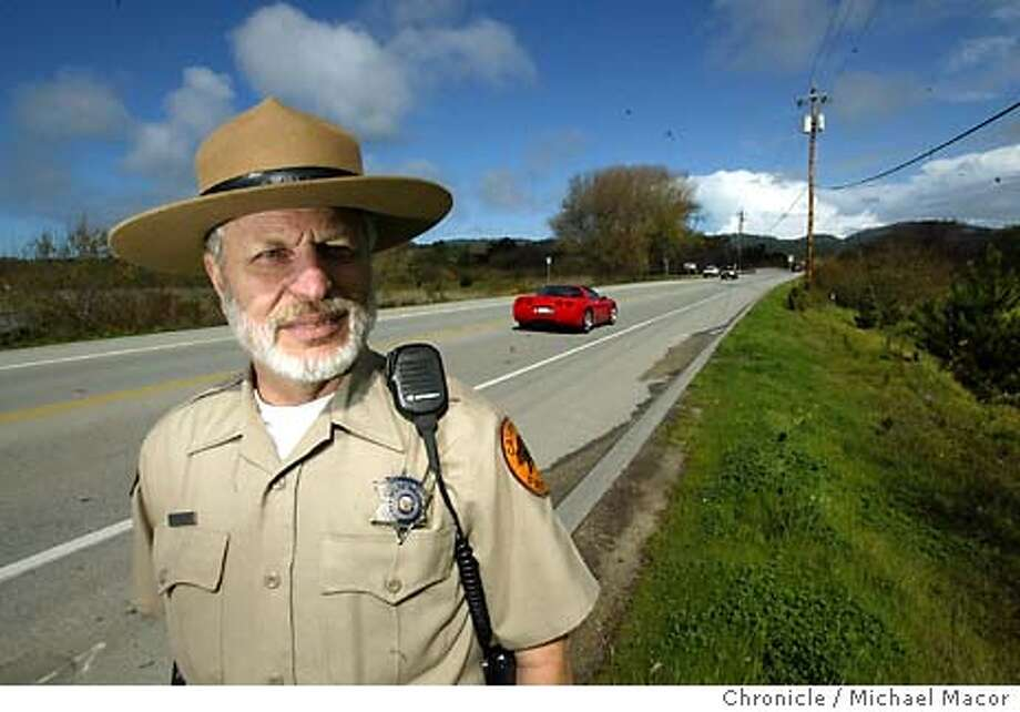 "California State Parks Ranger Chuck Bancroft has been a Ranger at Point Lobos for the past 23 years. Bancroft near the scene of an accident that involved 6 Feral Pigs and three vehicles last September. He arrived on scene a few hours after it happened. A stetch of Highway 1 south of Carmel has become a graveyard for Feral Pigs and a hazard for the drivers that hit them with their cars. The problem is so great that CalTrans has agreed to post ""Pig Crossing"" signs along the roadway. event on 2/18/04 in Carmel Michael Macor / San Francisco Chronicle Photo: Michael Macor"