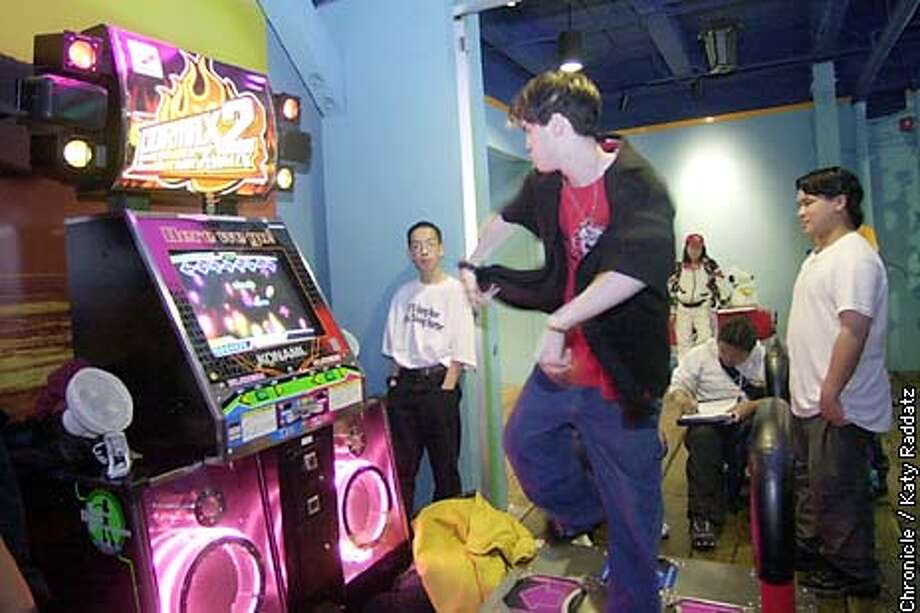 "PHOTO BY KATY RADDATZ--THE CHRONICLE  Will Chang, 16, of San Francisco, dances on a music game called ""bemani"" game at the Riptide Arcade at Pier 39."