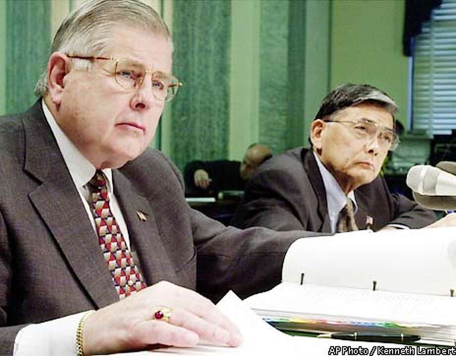 On Capitol Hill, John Magaw, left, undersecretary for transportation security and Transportation Secretary Norman Y. Mineta, right, testify before the Senate Commerce Committee, Tuesday, May 21, 2002, in Washington. The decision not to allow pilots to carry guns in cockpits was announced at the hearing. (AP Photo/Kenneth Lambert) Photo: KENNETH LAMBERT