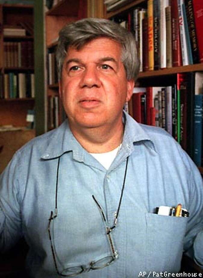 ** FILE ** Famed Harvard University biologist and author Stephen J. Gould, is shown at his Cambridge, Mass., office, in this 1997 file photo. Gould, 60, died Monday, May 20, 2002, of cancer at his home in New York. (AP Photo/The Boston Globe, Pat Greenhouse) Photo: PAT GREENHOUSE