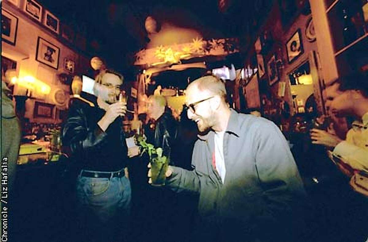 Tour guide Kyle Statham (front) stopping for a drink at the Lush. (BY LIZ HAFALIA/THE SAN FRANCISCO CHRONICLE)