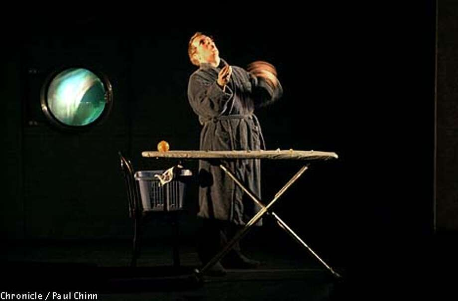 "An ironing board is a versatile prop for Robert Lepage, who wrote, directed and performs ""the far side of the moon."""