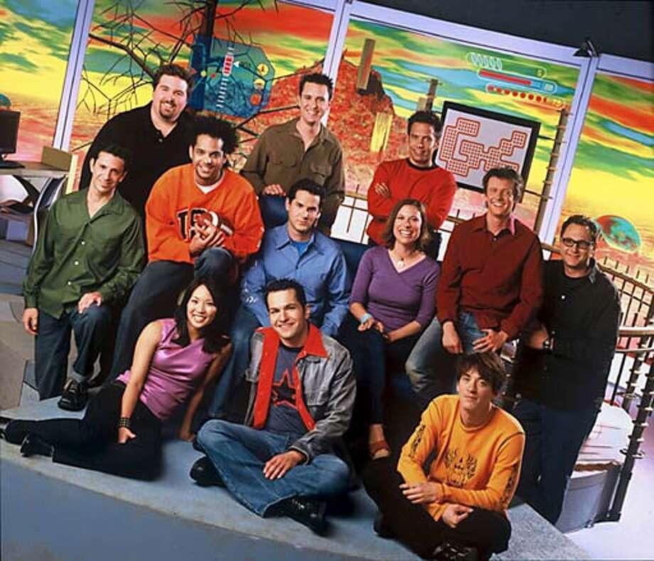 The staff of G4: Bottom row, from left: Diane Mizota, Bill Sindelar, Randy Kagan; middle row: Scot Rubin, Ronnie Lewis, Dave Meinstein, Dorothea Coelho, Cory Rouse, Jim Downs; top row: Travis Oates, Wil Wheaton, Matt Gallant.