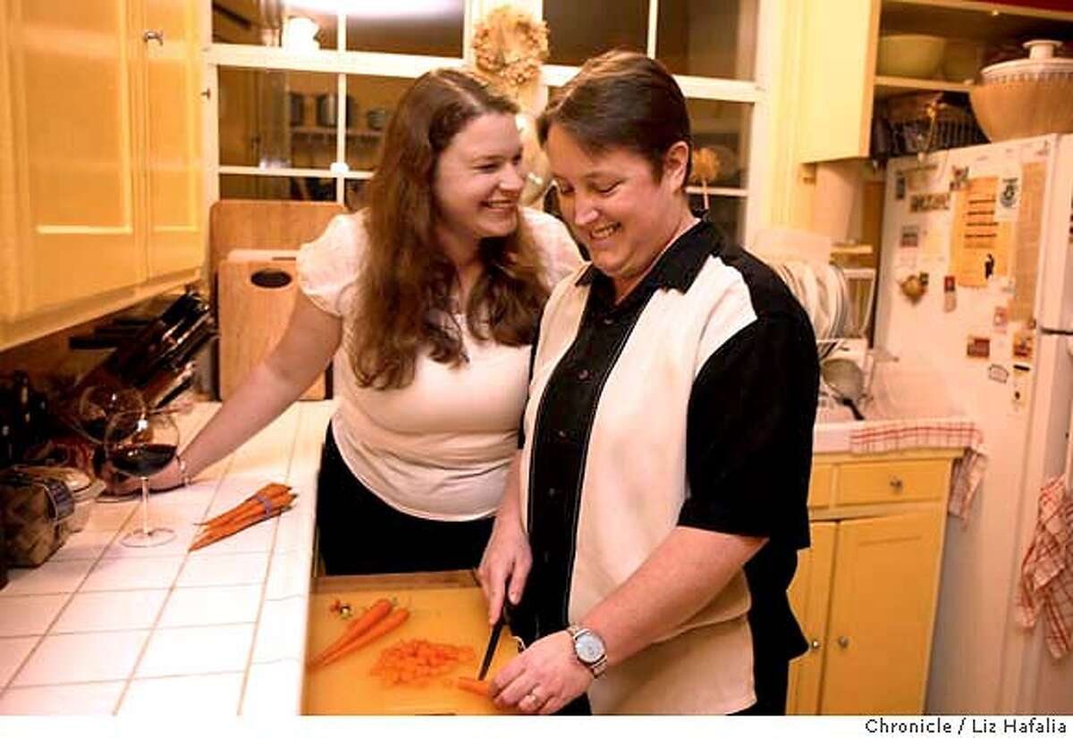 Darby Hoover (short hair) and Laura Brezel (longer hair already had their wedding in July and didn't feel compelled to marry again. Shot on 2/19/04 in Oakland. LIZ HAFALIA / The Chronicle