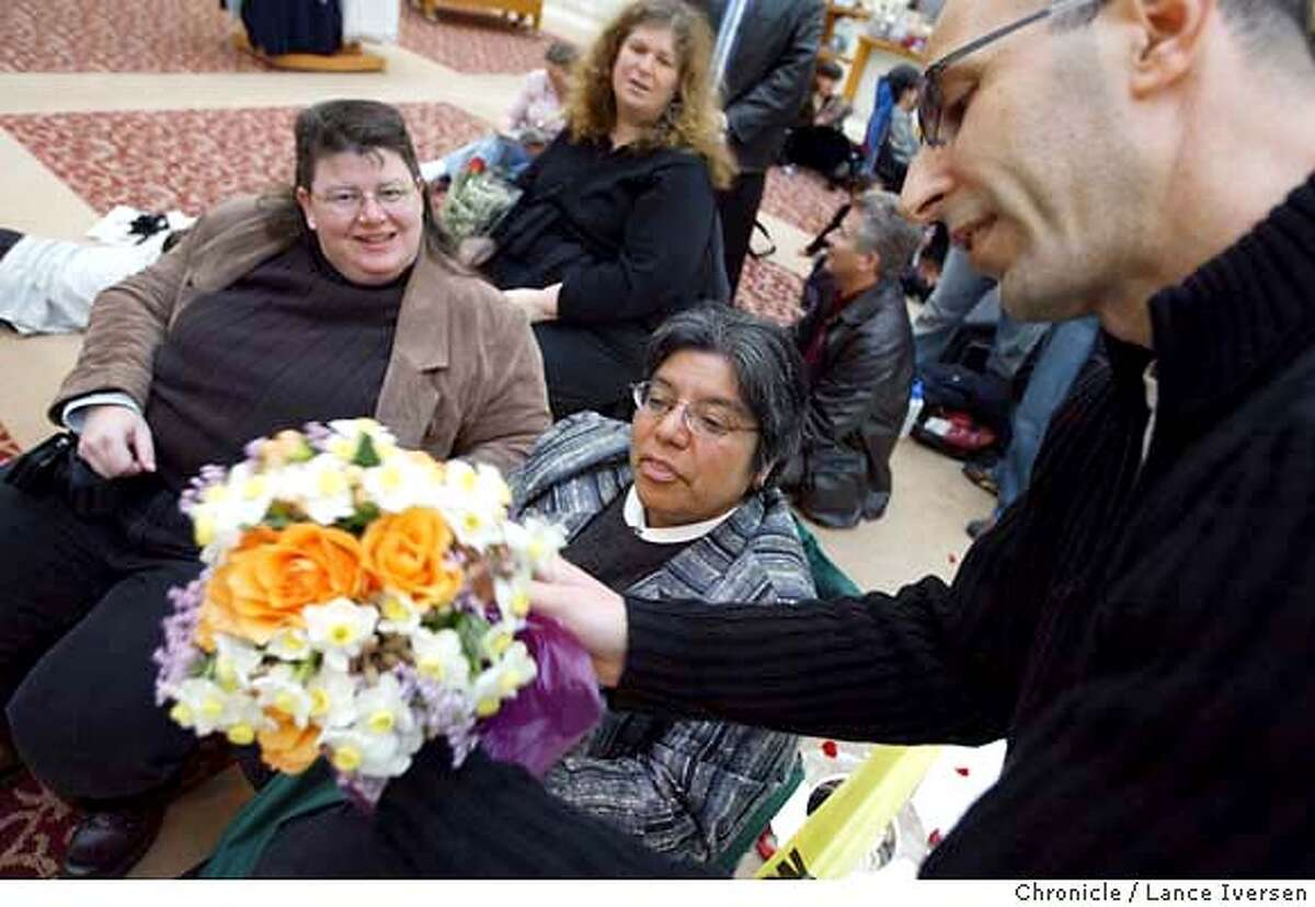 SAMESEX154_LI.JPG event on 2/20/04 in SAN FRANCISCO. Flowers in the Heartland is a new program fuelled by the web in which people from the Midwest call florists in San Francisco to deliver flowers to same sex couples getting married at City Hall. Michael Ritz from Church Street Flowers (right) delivers flowers to Lisa Clayton and Sally Canjura while they waited inside City Hall. The card simply read happy wedding from Minnesota. By Lance Iversen /The San Francisco Chronicle