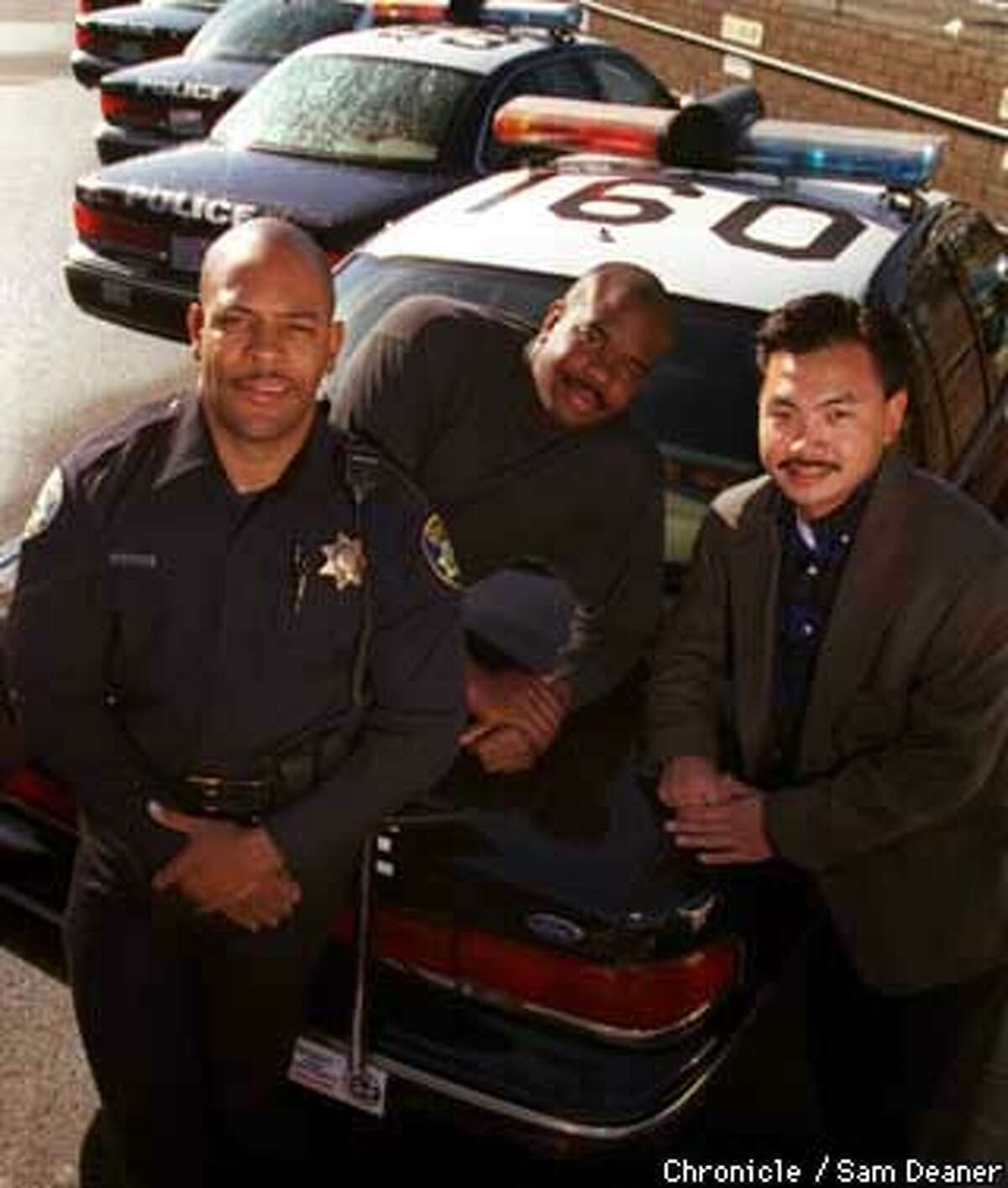 Vallejo Police Officers Stephen Darden, left, Donald Jewell, center, and Stan Eng are featured in the calendar 'California's Finest Men in Blue' to project a positive police image and raise money for the Vallejo Community Outreach Program. (Chronicle Photo by Sam Deaner)