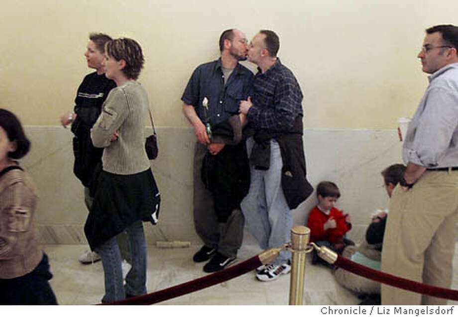 Event at San Francisco on 2/18/04. Same Sex marriages continue at City Hall in San Francisco, with lines of coules trying to get married. Tim Morano, left, and John O'Leary, right, kiss in line as they wait to get a marriage license at City Hall. The couple have been together for 14 years and live in San Francisco.Left is robin Marks(farleft) and Dominique Bailey from Roseville near Sacramento. On the far right side of the image is John Johnson, from Sacramento, whose son Jack Patten, 5, is on the ground. Liz Mangelsdorf/ The Chronicle Tim Morano, left, and John O'Leary wait in line to marry at City Hall in San Francisco. Photo: LIZ MANGELSDORF