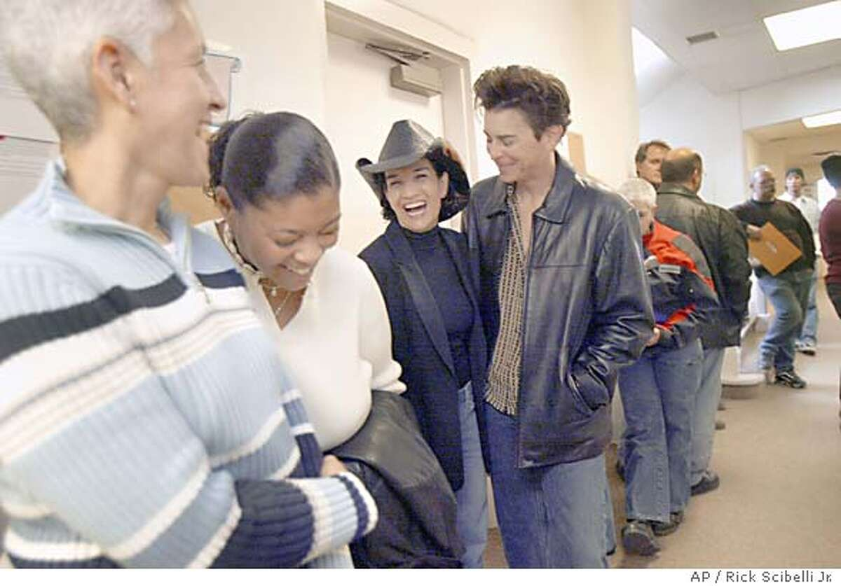 (L-R) Sally Rodriguez, Kimula Shoffner, Renae Figueroa and Joanne O'Connell line up outside of the clerks office to obtain their marriage licenses at the Sandoval County Courthouse in Bernalillo, N.M. on Friday, Feb. 20, 2004. Sandoval County starting issuing marriage lisences to same sex couples Friday morning after the counties attorney deemed that New Mexico law was not clear and that refusing to issue the licenses to same-sex couples could open the county to legal liability.(AP Photo/Rick Scibelli Jr.)