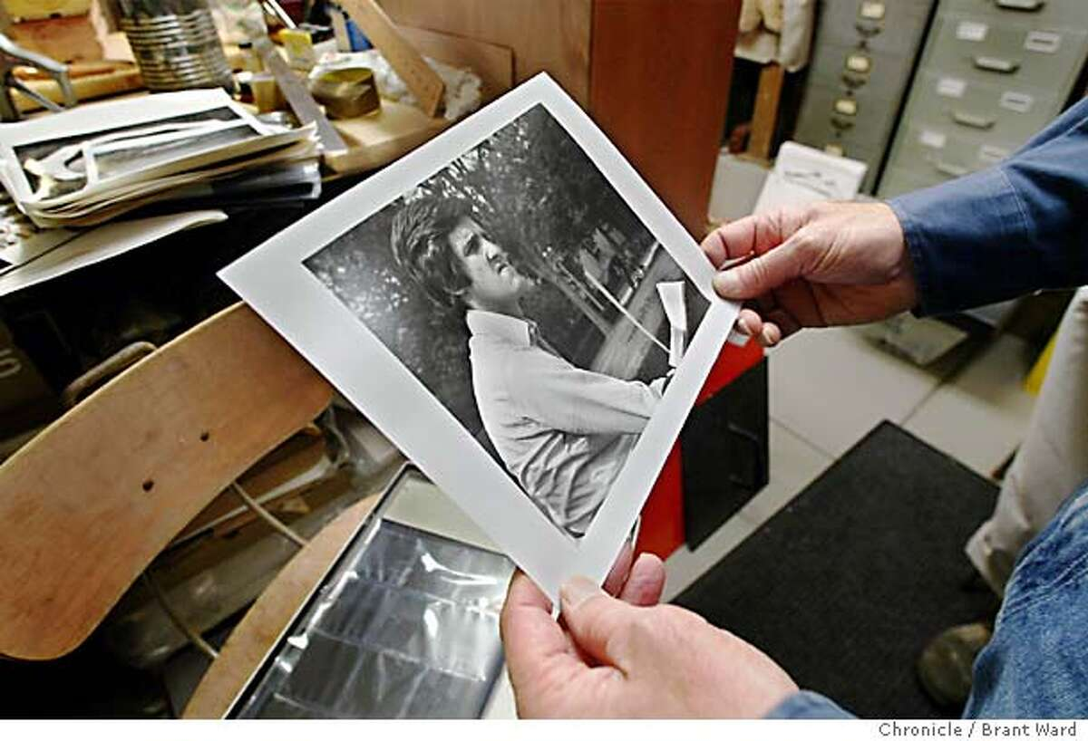 Photographer Ken Light took a picture of John Kerry in 1971 at a rally. Now someone has taken that photo and combined it with a photo of Jane Fonda to make it appear like they were together at an anti-war rally. Here Light holds a copy of the 1971 photograph, while in his basement darkroom, which has caused such controversy. BRANT WARD / The Chronicle