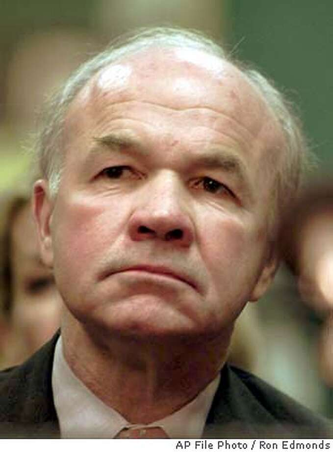 ** FILE ** Former Enron CEO Kenneth Lay gives brief remarks before he exercised his constitutional rights and refused to testify at a Senate Commerce Committee hearing on Capitol Hill Tuesday, Feb. 12, 2002, in Washington. With former Enron Corp. chief executive Jeffrey Skilling indicted, the fate of Lay is perhaps the biggest question hanging over the escalating federal investigation into wrongdoing at the fallen energy giant. (AP Photo/Ron Edmonds) Photo: RON EDMONDS