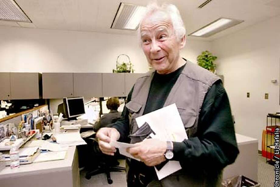 Franciscan monk , Brother George Cherrie, opening another donated check in his mail. He has raised over 120,000 dollars for the AIDS WALK over the past 10 years.  (PHOTOGRAPHED BY LIZ HAFALIA/THE SAN FRANCISCO CHRONICLE) Photo: LIZ HAFALIA