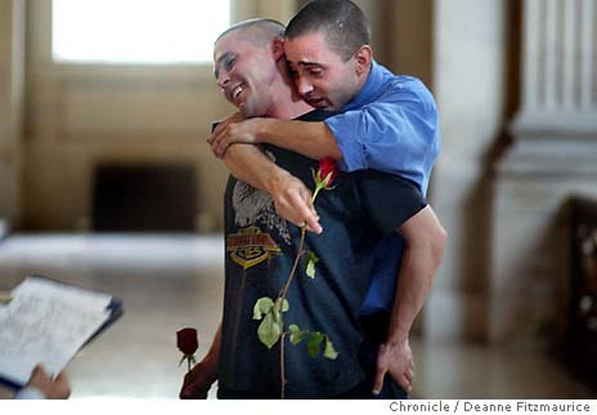 Frank Capley, 29, and Joe Alfano, 33, hug after their wedding ceremony. Same-sex couples were allowed to continue getting married today at City Hall as a decision was made in court today to allow marriages to coninue through Friday. Deanne Fitzmaurice / The Chronicle