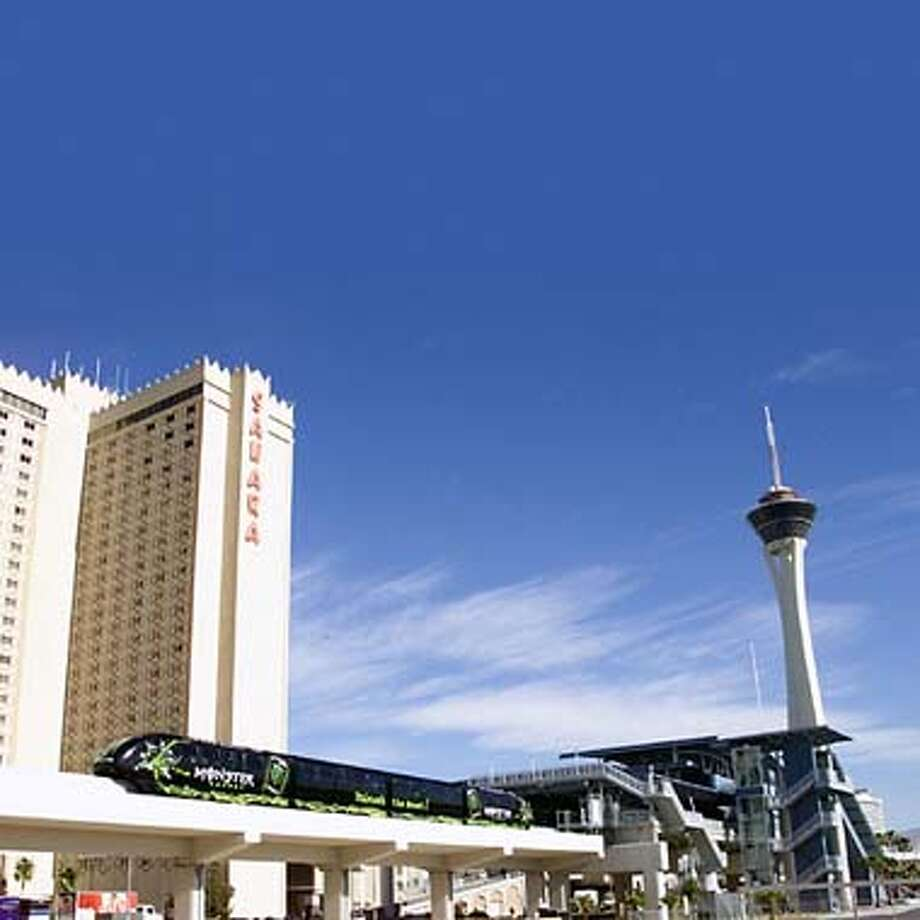 / for: Metro The Las Vegas Monorail is scheduled to open in March 2004. The $650 million, state-of-the-art transportation system will run along the Las Vegas resort corridor and travel at a top speed of 50 mph. Nine trains consisting of four cars each will run on a single rail that rises 20 feet high in most areas, its highest point reaching 70 feet above the Las Vegas Convention Center. The Las Vegas Monorail will connect eight major resorts, linking more than 24,000 hotel rooms and about 4.4 million square feet of meeting and convention space. Photo: �
