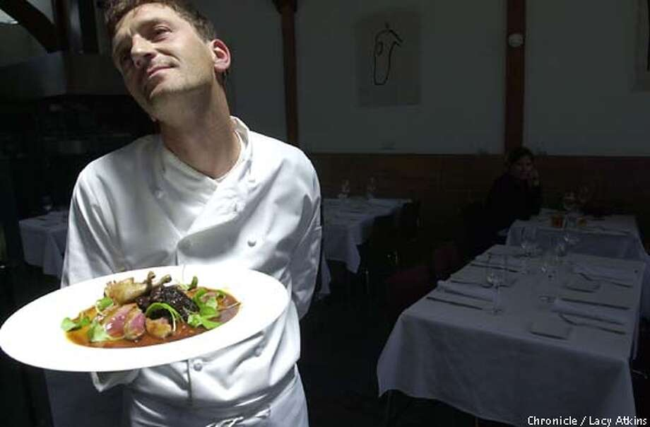 WHATS12-C-8JUNE02-FD-LA  CHEF LAURENT KATGELY POSES AS HE SHOWS OFF HIS DISH (SQUAB) TO THE CAMERA IN HIS NEW FRENCH RESTUANT CHEZ SPENCER.  PHOTO BY LACY ATKINS/CHRONICLE