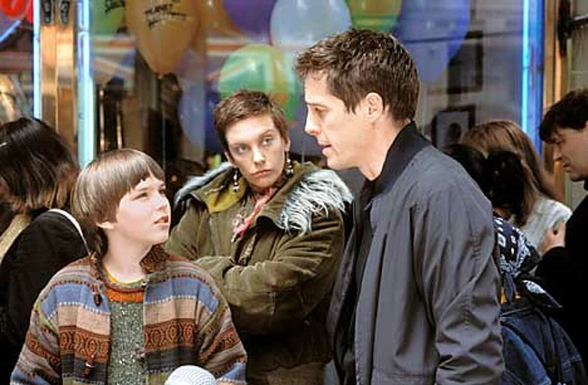 Marcus (NICHOLAS HOULT) and his mom Fiona (TONI COLLETTE) often differ in their reactions to Will (HUGH GRANT). Photo: Laurie Sparham (HANDOUT PHOTO)