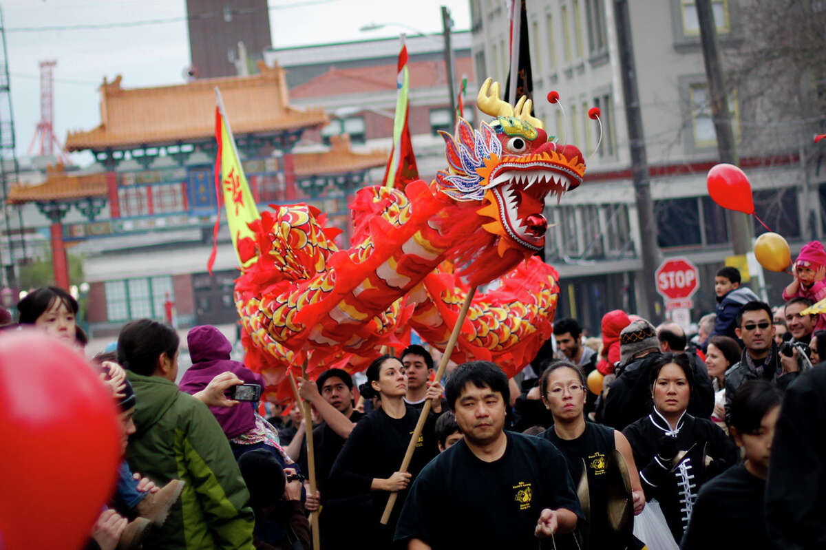 Lion dancers with the David Leong's Shaolin Kung Fu Academy perform at the Annual Lunar New Year Festival in the International District in Seattle on Sat. Jan. 28, 2012. Hundreds of families participate in a variety of cultural events and watch performances ranging from dragon dances to martial arts.