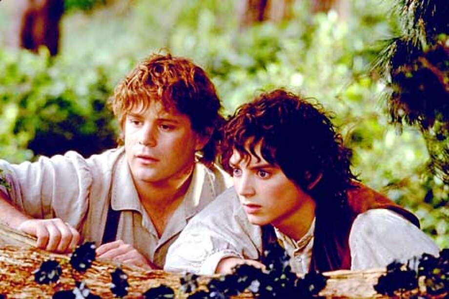 Elijah Wood (right) as Frodo (pictured here in a scene with actor Sean Astin) communicates a hobbit's innocence and curiosity nicely, but there's an inevitable lack of gravitas when he shares the screen with Ian McKellen (not pictured)