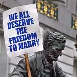 ; A statue of President Lincoln outide SF Cith Hall on President Day made a statement about Freedom and Marriage. Today may be the last day of a marriage frenzy that began Thursday when Mayor Gavin Newsom directed city officials to begin issuing marriage licenses to gay and lesbian couples. Since then hundreds of same-sex couples have trooped through City Hall to take advantage of the opportunity. Opponents of same-sex marriage, who have filed suit against the city, said they will return to court Tuesday to seek a temporary restraining order to stop the weddings. But those camped outside City Hall on Sunday night said it was worth the wait even if the licenses are eventually invalidated as the line went around the block at SF City Hall.  City:� 2/16/04, in San Francisco, CA. Frederic Larson/The Chronicle;