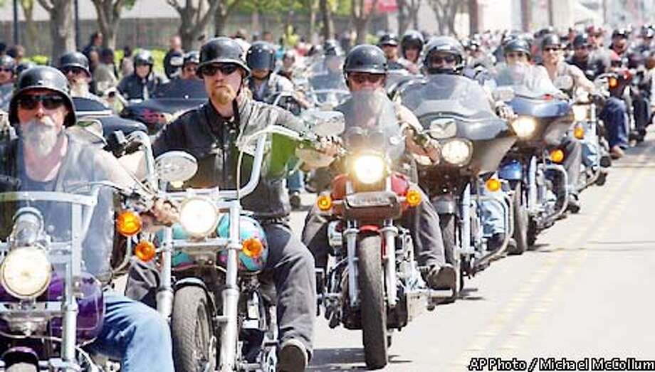 Hundreds of bikers head to the cemetery Saturday, May 4, 2002, in Stockton, Calif., for the burial of Stockton motorcycle shop owner and Hells Angel member Robert Emmett ``Festes'' Tumelty, 50, who was killed last Saturday during a fight with a rival gang in a casino in Laughlin, Nev. (AP Photo/The Record, Michael McCollum) Photo: MICHAEL MCCOLLUM