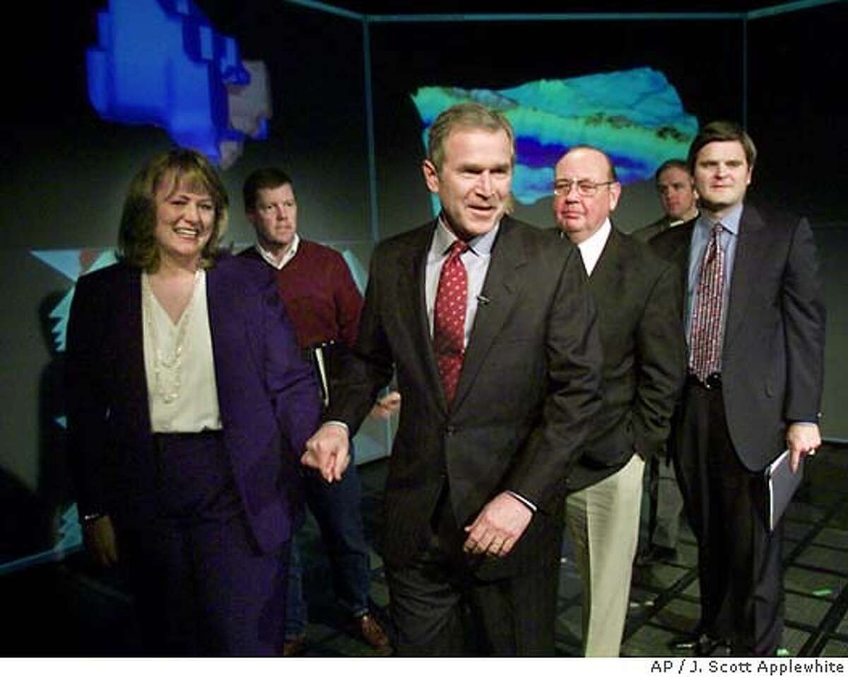President-elect Bush smiles as he finishes a meeting with technology leaders, at the University of Texas in Austin, Thursday, Jan. 4, 2001. Walking with Bush are, from left: President and CEO of AutoDesk Carol Bartz, Chairman and CEO of Sun Microsystems Scott McNealy, Richard Egan, founder of EMC Corporation, and Steve Case, chairman of AOL Time-Warner. (AP Photo/J. Scott Applewhite) CAT