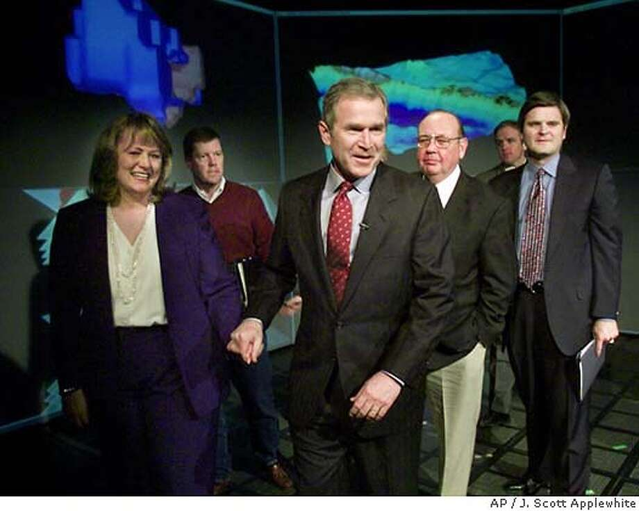 President-elect Bush smiles as he finishes a meeting with technology leaders, at the University of Texas in Austin, Thursday, Jan. 4, 2001. Walking with Bush are, from left: President and CEO of AutoDesk Carol Bartz, Chairman and CEO of Sun Microsystems Scott McNealy, Richard Egan, founder of EMC Corporation, and Steve Case, chairman of AOL Time-Warner. (AP Photo/J. Scott Applewhite) CAT Photo: J. SCOTT APPLEWHITE