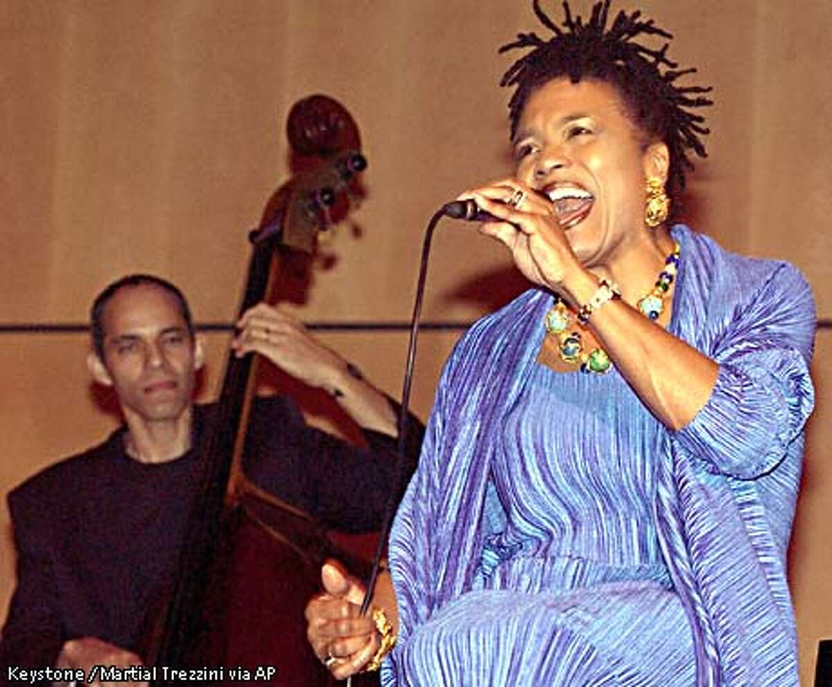 U.S. singer Dee Dee Bridgewater performs on stage at the general assembly hall, on the occasion of the United Nations Staff Gala, at the United Nations Headquarters in Geneva, Switzerland, late Friday, Nov. 23, 2001. (AP Photo/Keystone, Martial Trezzini)