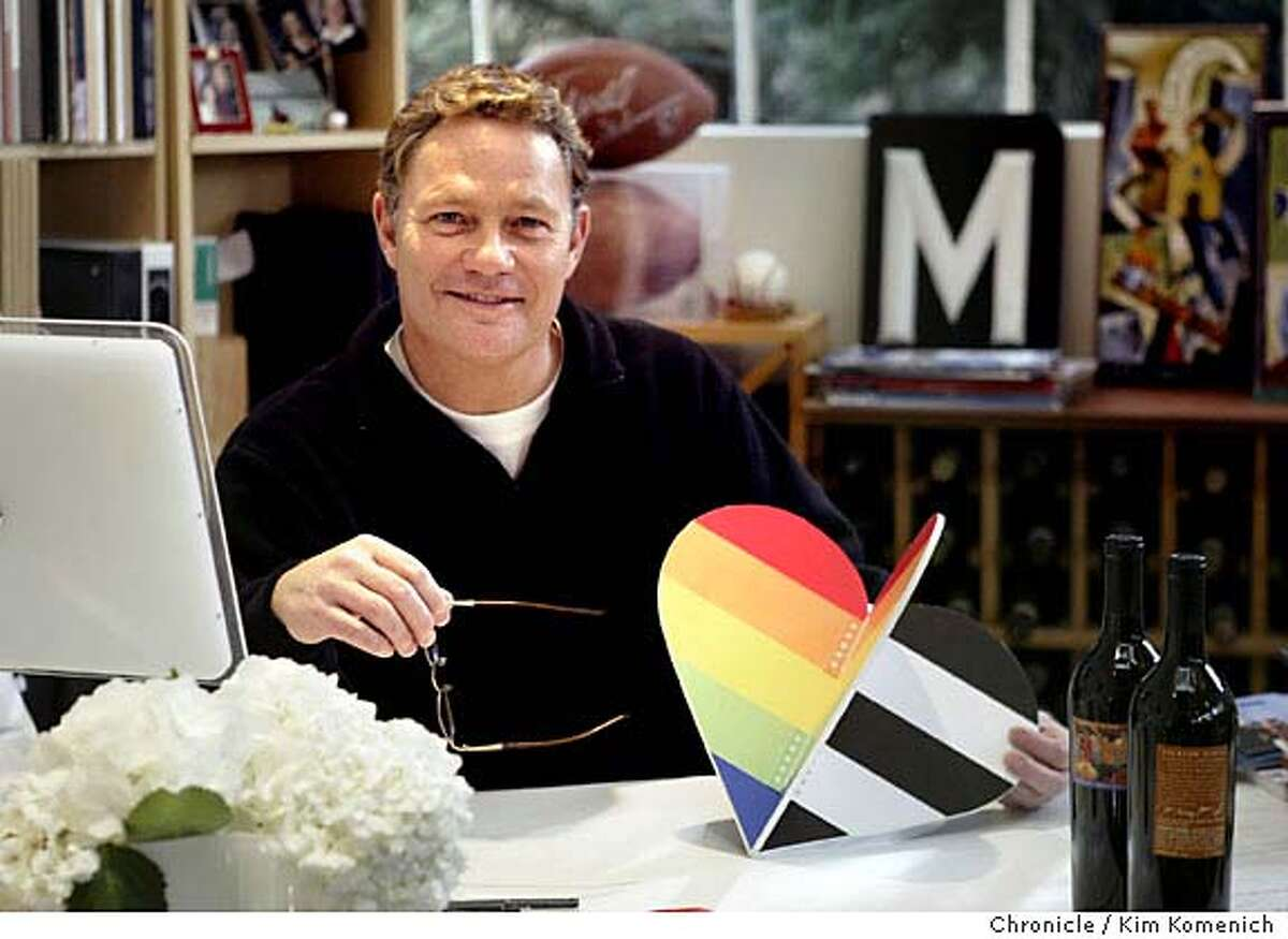 HEARTS_005_kk.jpg At his desk in his office he holds a mock-up of one of the five-foot hearts. Michael Osborne has designed two five foot-tall sculptures in the shape of a heart to be part of the