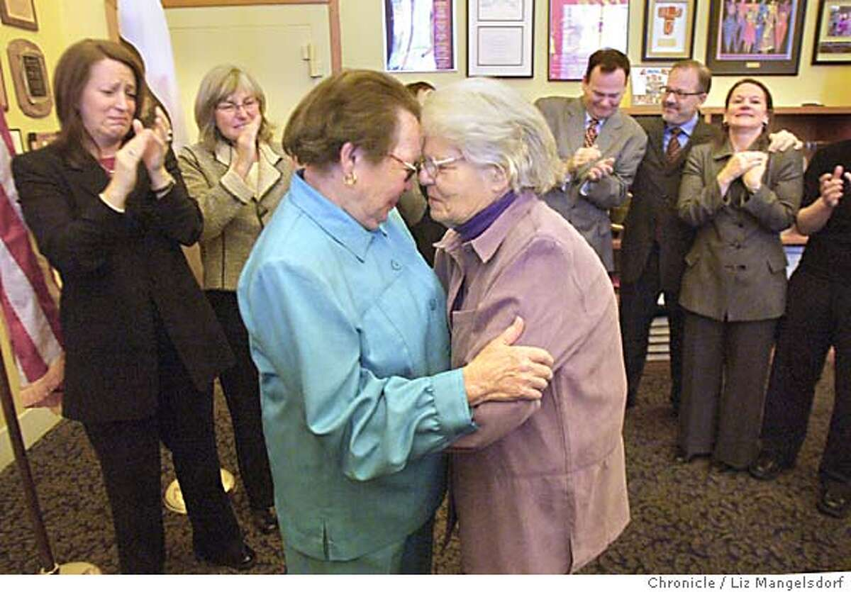 A69C0585.JPG Phyllis Lyon, 79, left, and Del Martin, 83, right, look at each other after being married at city hall. The are the first legally married same-sex couple in San Francisco. In the background is Kate Kendell, Executive director of the National Center for Lesbian Rights, far left. Next to her is Raberta Achtenberg, Senior Vice President of the SF Chamber of Commerce. From Mayor Newsom's office on behind the couple on the right are, from left Joe Caruso, head of Neighborhood services, Steve Kawa, Chief of Staff, and Joyce Newstat, director of Policy for the mayor's office. The first legally married same-sex couple in San Francisco are married by City assessor/Recorder mabel Teng in her office at City Hall. Phyllis Lyon and Del Martin, who have been together for 51 years say their vows. LIZ MANGELSDORF/ The Chronicle
