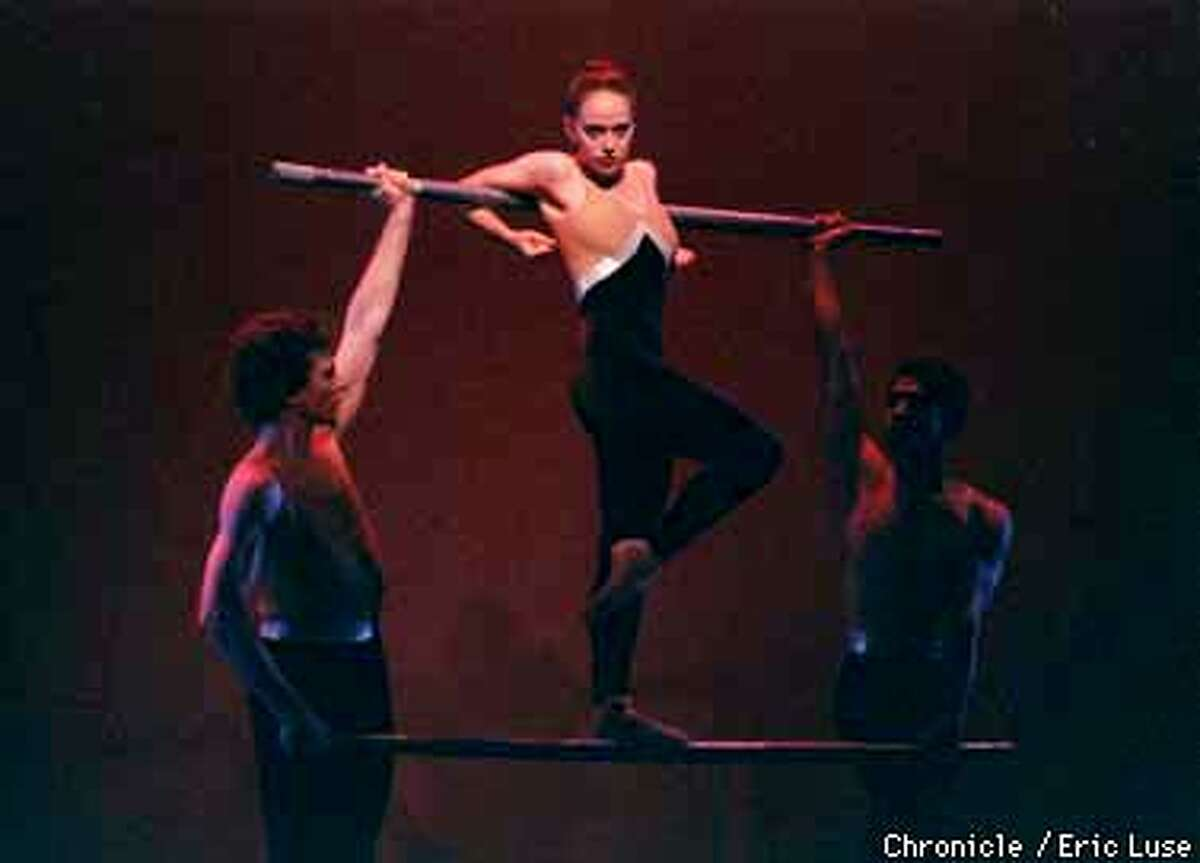 Dancer Amy London with (left) Lee Bell and (right) Osnani Garcia during Michael Smuin's