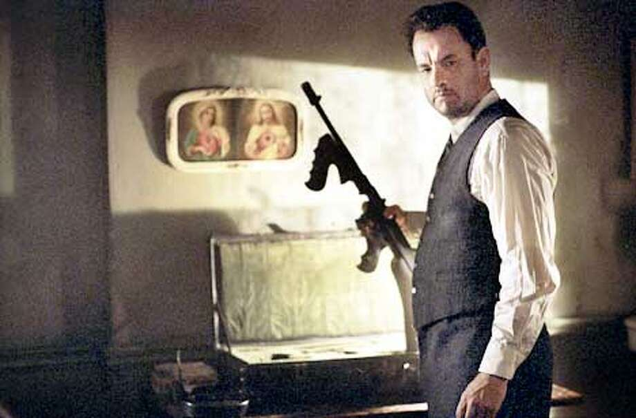 Michael Sullivan (TOM HANKS) has just one more job to do in DreamWorks Pictures� and Twentieth Century Fox�s ROAD TO PERDITION. Photo: Francois Duhamel (HANDOUT PHOTO) Photo: HANDOUT