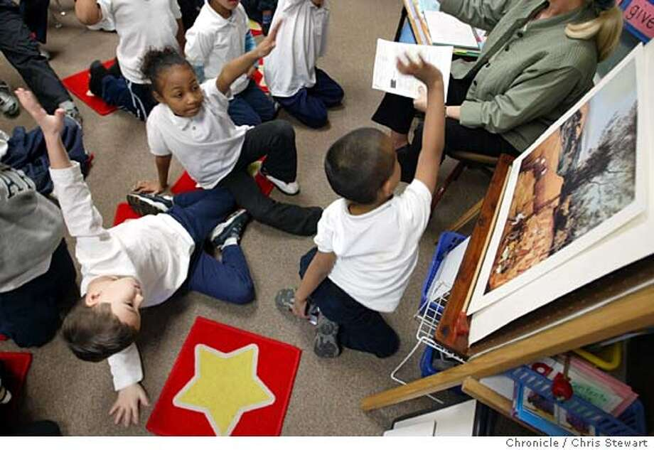 "Event on 1/21/04 in San Francisco.  A squirmy Kevin Banals (L) is joined on the floor by Sopannary K. Bey (cq C) and Gabriel Juan (R) as they vie for their teacher's attention in Susie Scurich's 1st grade class at Marshall Elementary School in the Mission. The students are learning how to view, analyze and think critically about art. Organizers say the program seeks to ""bring the magic of art back to San Francisco students"" at a time when the state has slashed the budget for arts eduction. The program, which originated at the Museum of Modern Art in New York, is run by the nonprofit foundation of a San Francisco art gallery. Chris Stewart / The Chronicle Photo: Chris Stewart"