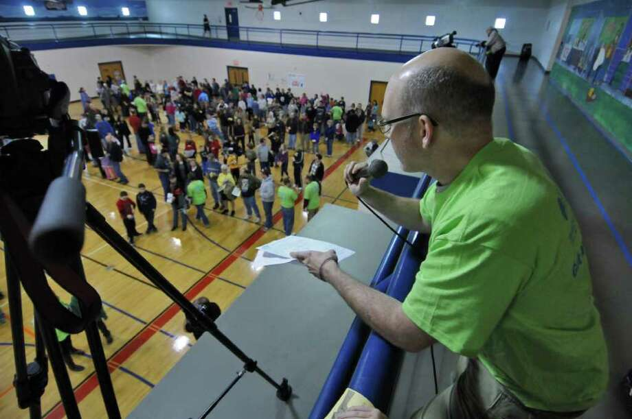 Times Union state editor Casey Seiler emcees the Fit as a Family Fist Bump at the Southern Saratoga YMCA, where an unofficial world's record was set by 428 participants on Sunday Jan. 29, 2012 in Clifton Park, NY.  (Philip Kamrass / Times Union ) Photo: Philip Kamrass / 00016224A