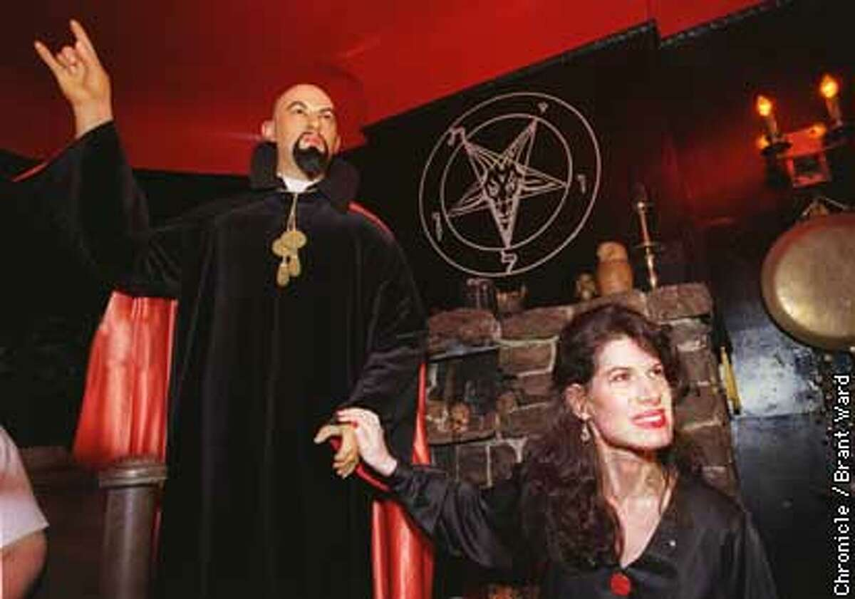 The High Priestess Karla LaVey held the hand of a wax statue of her father Anton LaVey at a press conference announcing his death. By Brant Ward/Chronicle
